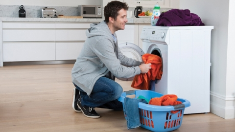Man using washing machine