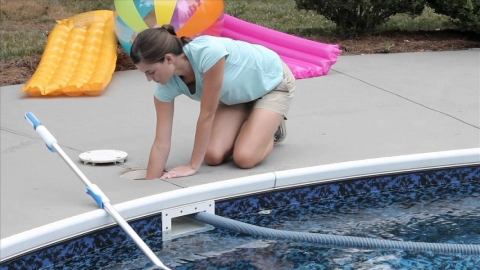 Woman cleaning pool filter