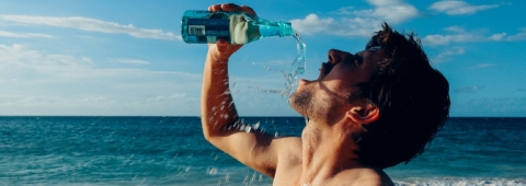 Thirsty man drinking water